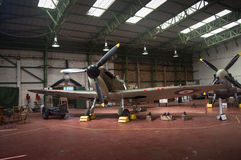 Spitfire in hanger - WWII royalty free stock image