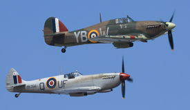 Spitfire and Hurricane from the Battle of Britain Memorial Flight (BBMF) performing a flypast. Supermarine Spitfire and Hawker Hurricane from the Stock Photography