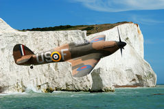 Spitfire over the white cliffs of Dover. South coast of England royalty free stock photos