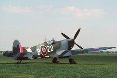 Spitfire Parked. British mark IX Spitfire parked beside a grass runway royalty free stock photos