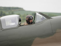Spitfire Pilot. Duxford, UK - May 23rd 2015: Pilot of a vintage British Spitfire Mk 1 fighter , displaying at Duxford VE Day Airshow Royalty Free Stock Image