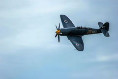 Spitfire Plane. A photo of Spitfire during flight on a mild english afternoon. Made possible by yeovilton airshow Stock Images