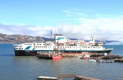 Spitsbergen/Ny-Ã…lesund: Cruise Ship. A Finnish cruise ship and a Dutch two-master are moored in the little harbor of Ny-Ã…lesund; ice/snow melting in the stock photography