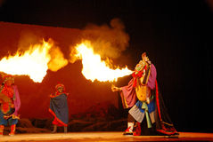 Spitting fire. Sichuan opera  displays its unique skills: the changing faces and spitting fire Royalty Free Stock Image