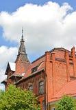Spitze auf dem Gebäude der ehemaligen deutschen psychiatrischen Klinik 1902 Gvardeysk, Kaliningrad-Region Stockfotografie