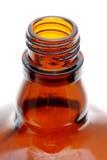Spitze der geöffneten braunen Flasche Stockfotografie