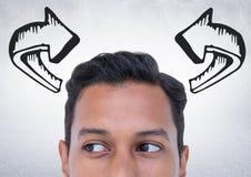 Spitze des Männerkopfs und des grauen Pfeiles gegen weiße Wand Lizenzfreies Stockbild