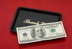 Spitzen Sie Geld Stockbild
