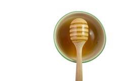 Spitzenaugenansicht-Honigschöpflöffel lokalisiert für Netz Stockfotos