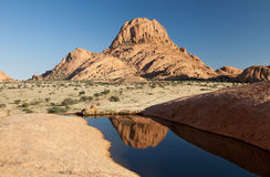 Spitzkoppe. Water mirroring picture of Spitzkoppe mountain at Namibia, exceptional view, as there is no water usually in this area stock photography