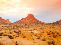 Spitzkoppe, aka Sptizkop - unique rock formation of pink granite in Damaraland landscape, Namibia, Africa Stock Photos