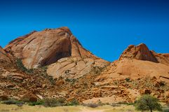 Spitzkoppe Mountain (Namibia). The Spitzkoppe (also referred to as Spitzkop, Groot Spitzkop, or the Matterhorn of Namibia), is a group of bald granite peaks stock photos