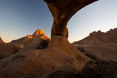 Spitzkoppe. Mountain of Spitzkoppe seen from and with Rock Arch in Spitzkoppe National Park, Namibia, Africa, at sunrise stock photos