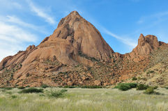 Spitzkoppe, Namibia. Greater Spitzkoppe, Namibia with grass field in the foreground stock photo
