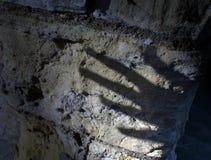 spöklik handskugga Arkivfoto