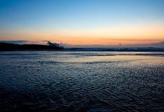 Splash. Strong waves at sunset hitting the small island near the shore at Kovalam beach, Kerala, India Stock Photo