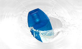 Splash. A blue bottle perfume splahed into the water Stock Image