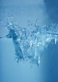 The splash. Icecubes falling in water with a big splash Royalty Free Stock Photos