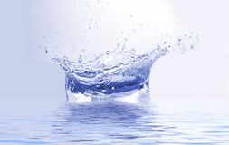 Splash. Sparks of blue water on a white Royalty Free Stock Photography