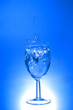 Splash. Water splash in wine glass Royalty Free Stock Photos