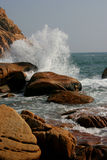 Splash. A wave breaking onto the rocky shore at Shek O Beach in Hong Kong Stock Photo