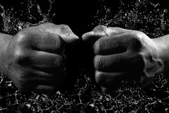 Splash. Black and white hands of man hit on water Royalty Free Stock Photography