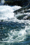 Splash. Wave breaking on the rocks royalty free stock photos