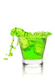 Splash in absinthe liqueur with ice cubes Stock Images