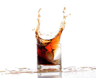 Splash alcohol water  in glass isolated. On white Stock Photography
