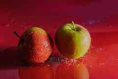 Splash - apple fall into the water Royalty Free Stock Photo