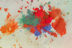 Splash blots color orange red green blue on a white background Stock Images