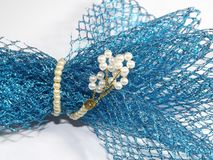 A splash of blue lace wrapped by pearls royalty free stock images