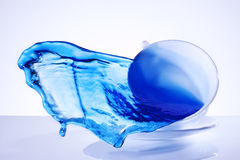 Splash blue water cup Royalty Free Stock Photography