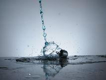 Splash bulb. Blue water impact with antique light bulb Royalty Free Stock Photo
