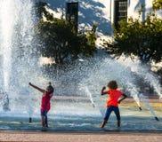 Splashing in a Fountain Stock Photo