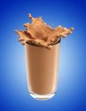 Splash of chocolate milk from the glass Stock Photo