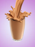 Splash of chocolate milk from the glass Royalty Free Stock Images