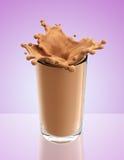 Splash of chocolate milk from the glass Stock Photos