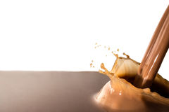Splash of chocolate, pouring stream jet of chocolate, cocoa, isolated. Chocolate liquid splash, pouring stream jet of chocolate, cocoa, isolated on white royalty free stock photography