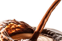 Splash of chocolate, pouring stream jet of chocolate, cocoa, isolated. Chocolate liquid splash, pouring stream jet of chocolate, cocoa, isolated on white royalty free stock photos
