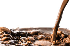 Splash of chocolate, pouring stream jet of chocolate, cocoa, isolated. On white background royalty free stock images