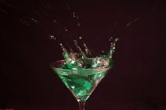 Splash Cocktail. A splash in a cocktail drink stock images