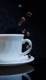 Splash of coffee and milk in white cup Stock Photo