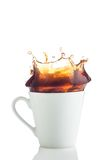 Splash of coffee in white cup Royalty Free Stock Photos