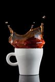 Splash of coffee in white cup Stock Photography