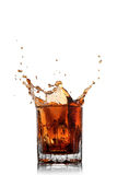 Splash of cola in glass isolated Stock Photos