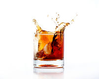 Splash of cola in glass isolated on white Stock Photos