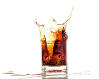 Splash of cola in glass isolated on white Stock Image