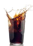 Splash of cola with ice cubes Stock Image