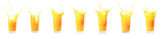 Splash collection in glass of orange juice royalty free stock photography